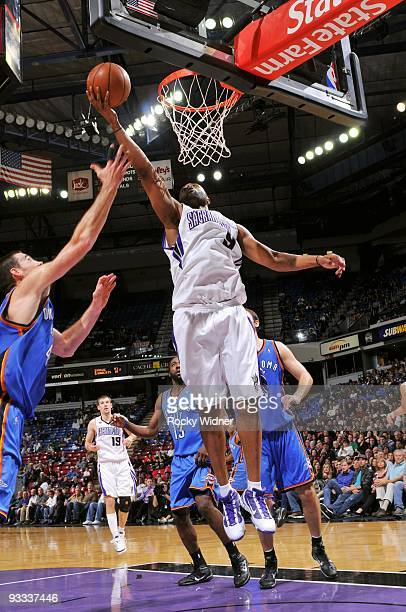 Kenny Thomas of the Sacramento Kings rebounds against Nick Collison of the Oklahoma City Thunder during the game at Arco Arena on November 10 2009 in...