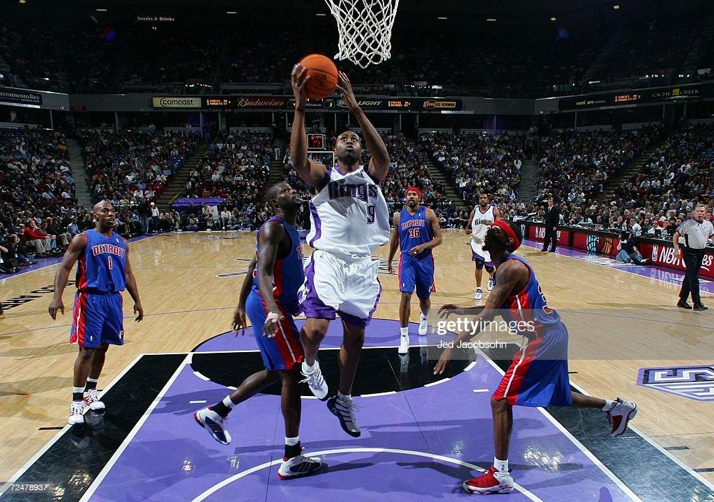 Kenny Thomas #9 of the Sacramento Kings rebounds the ball over Jason Maxiell #54 and Richard Hamilton #32 of the Detroit Pistons during an NBA game at Arco Arena on November 8, 2006 in Sacramento, California.