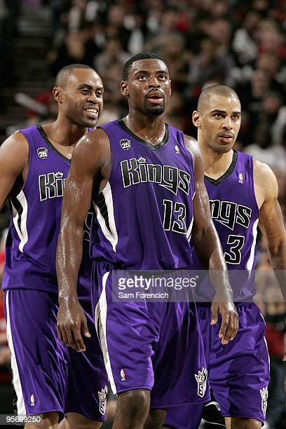 Kenny Thomas Tyreke Evans and Ime Udoka of the Sacramento Kings walk across the court during the game against the Portland Trail Blazers on December...