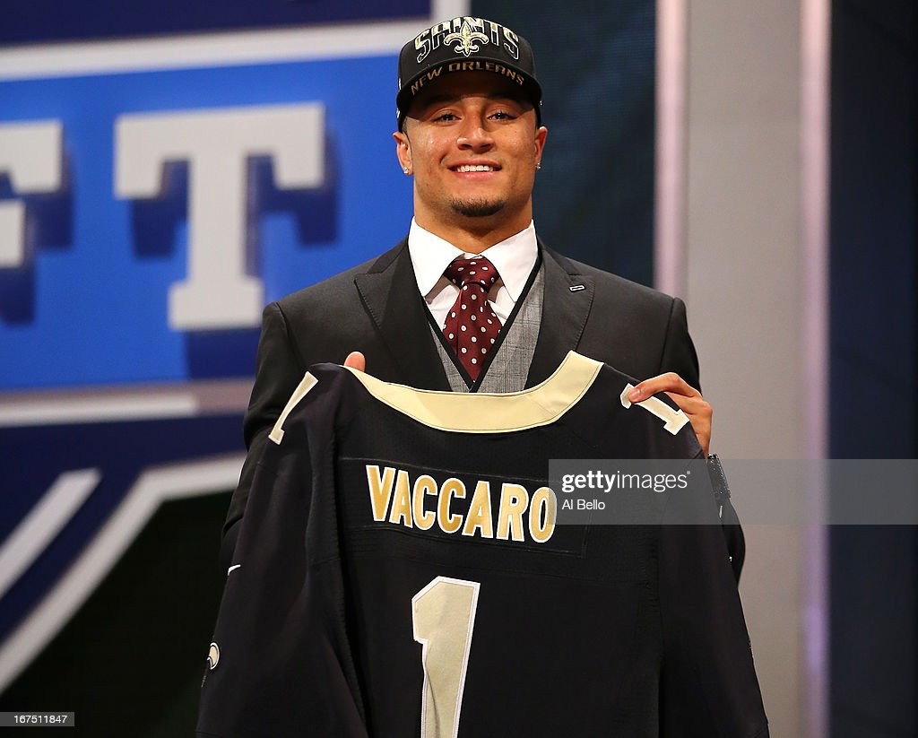 Kenny Vaccaro of the Texas Longhorns holds up a jersey on stage after he was picked #15 overall by the New Orleans Saints in the first round of the 2013 NFL Draft at Radio City Music Hall on April 25, 2013 in New York City.