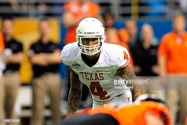 Kenny Vaccaro of the University of Texas Longhorns waits for the snap against the Oregon State Beavers during the Valero Alamo Bowl at the Alamodome...