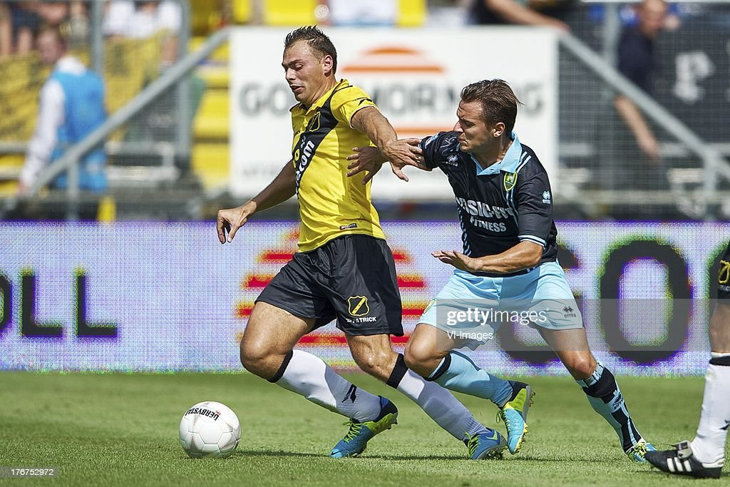 Kenny van der Weg of NAC Breda, Ricky van Haaren of ADO Den Haag during the Dutch Eredivisie match between NAC Breda and ADO Den Haag on August 18, 2013 at the Rat Verlegh stadium in Breda, The Netherlands.
