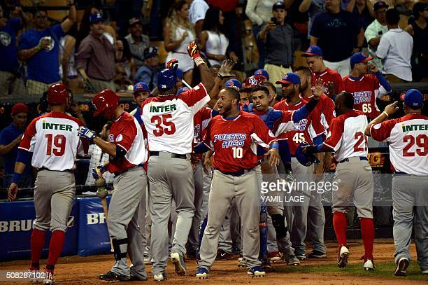 Kenny Vargas of Puerto Rican celebrates a homerun against Cuba during their 2016 Caribbean baseball series game on February 3 2016 in Santo Domingo...