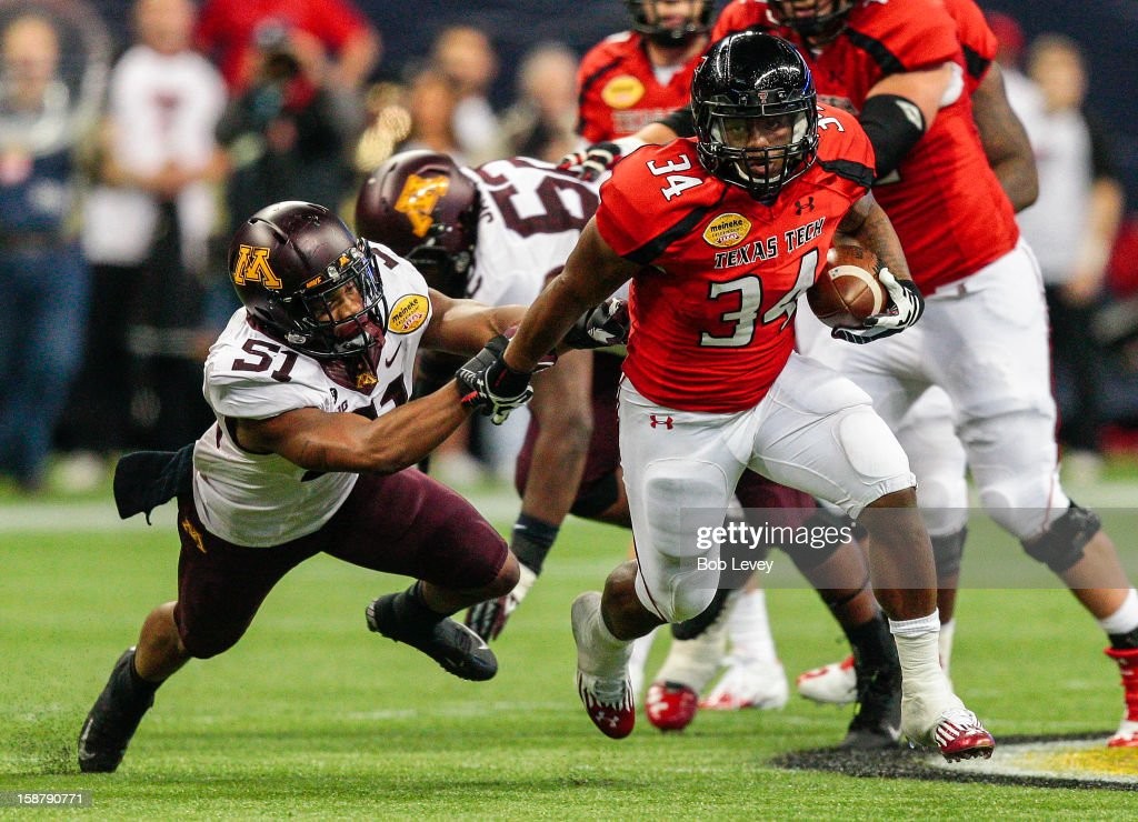 Kenny Williams #34 of the Texas Tech Red Raiders breaks a tackle attempt by the Texas Tech Red Raiders defense during the Meineke Car Care of Texas Bowl at Reliant Stadium on December 28, 2012 in Houston, Texas. Texas Tech defeated Minnesota 34-31.