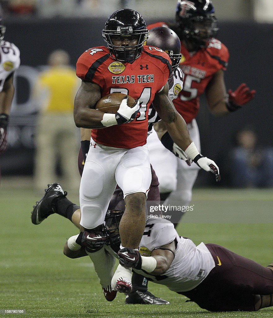 Kenny Williams #34 of the Texas Tech Red Raiders breaks loose from the grasp of <a gi-track='captionPersonalityLinkClicked' href=/galleries/search?phrase=Antonio+Johnson+-+American+Football+Player&family=editorial&specificpeople=2235167 ng-click='$event.stopPropagation()'>Antonio Johnson</a> #11 of the Minnesota Golden Gophers during the Meineke Car Care of Texas Bowl at Reliant Stadium on December 28, 2012 in Houston, Texas. Texas Tech defeated Minnesota 34-31.