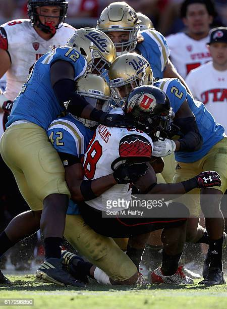 Kenny Young Jaleel Wadood and Jayon Brown of the UCLA Bruins tackle Joe Williams of the Utah Utes during the second half of a game at the Rose Bowl...