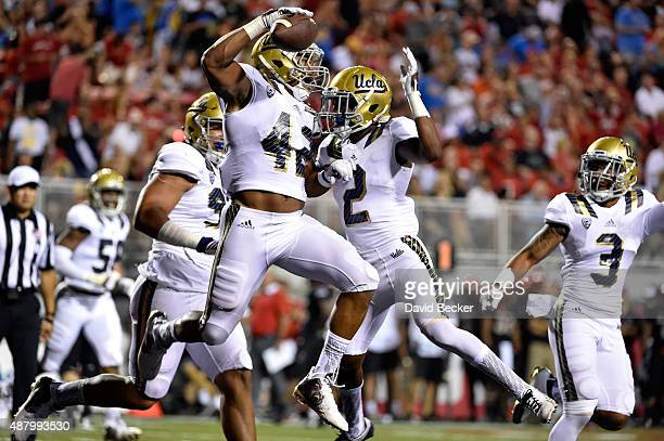Kenny Young of the UCLA Bruins celebrates scoring a touchdown after intercepting the ball from the UNLV Rebels during his game at Sam Boyd Stadium on...