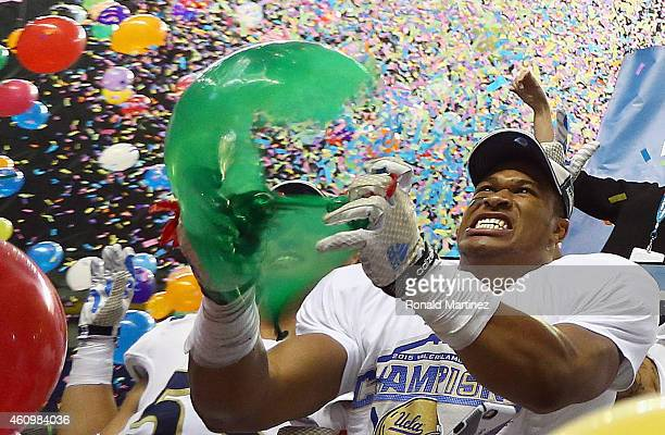 Kenny Young of the UCLA Bruins pops a ballon after a 4035 win against the Kansas State Wildcats during the Valero Alamo Bowl at Alamodome on January...