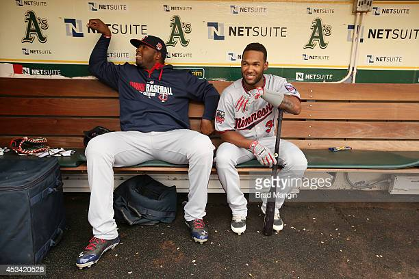 Kennys Vargas and Danny Santana of the Minnesota Twins get ready in the dugout before the game against the Oakland Athletics at Oco Coliseum on...