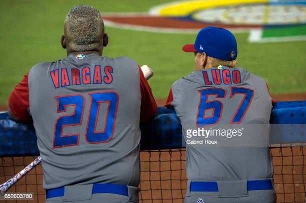 Kennys Vargas and Seth Lugo of Team Puerto Rico look on from the dugout during Game 4 of Pool D of the 2017 World Baseball Classic against Team...