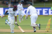Kenroy Peters gets run out by Dale Steyn and AB de Villiers during day 4 of the 2nd Test match between South Africa and West Indies at St Georges...