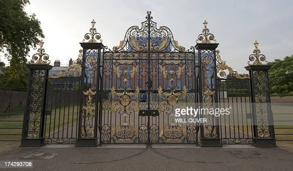 Kensington Palace gates seen in the late evening light after the arrival of Prince William and Catherine Duchess of Cambridge and their newborn baby...