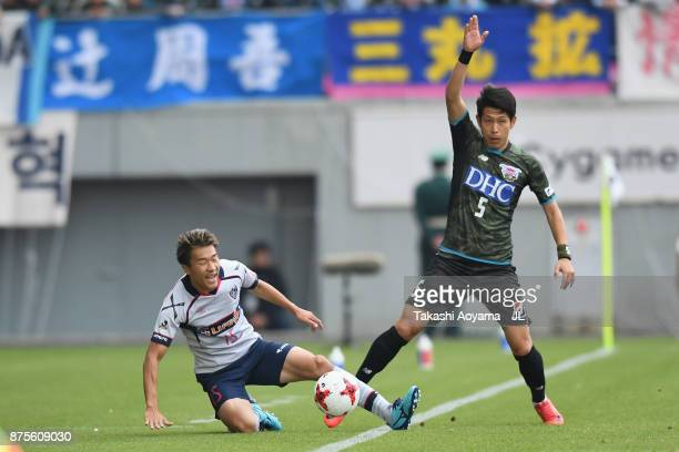 Kensuke Nagai of FC Tokyo and Kim Min Hyeok of Sagan Tosu compete for the ball during the JLeague J1 match between Sagan Tosu and FC Tokyo at Best...