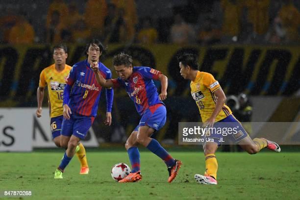 Kensuke Nagai of FC Tokyo and Takuma Nishimura of Vegalta Sendai compete for the ball during the JLeague J1 match between FC Tokyo and Vegalta Sendai...