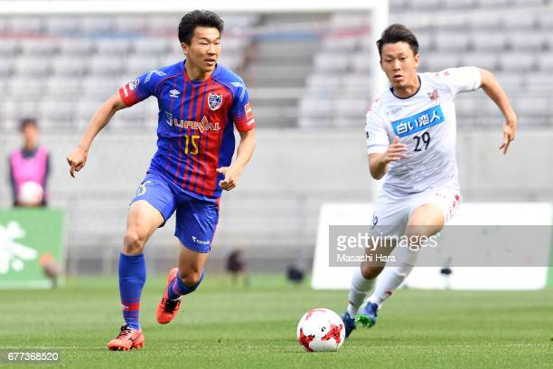 Kensuke Nagai of FC Tokyo and Yuto Nagasaka of Consadole Sapporo compete for the ball during the JLeague Levain Cup Group A match between FC Tokyo...