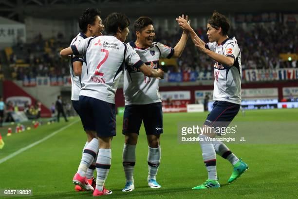 Kensuke Nagai of FC Tokyo celebrates scoring the opening goal with his team mates during the JLeague J1 match between Vissel Kobe and FC Tokyo at...
