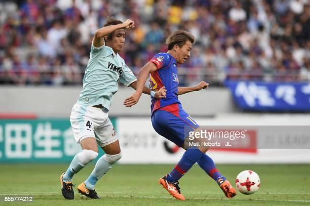 Kensuke Nagai of FC Tokyo controls the ball under pressure of Shohei Takahashi of Jubilo Iwata during the JLeague J1 match between FC Tokyo and...