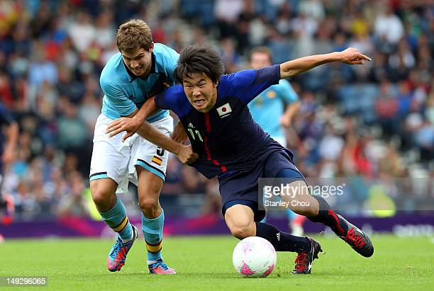 Kensuke Nagai of Japan clashes with Inigo Martinez of Spain during the Men's Football first round Group D Match of the London 2012 Olympic Games...