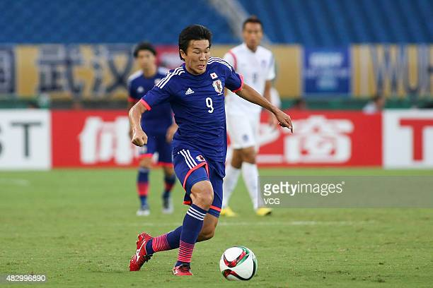 Kensuke Nagai of Japan follows the ball in group match between Japan and South Korea during EAFF East Asian Cup 2015 at Wuhan Sports Center Stadium...