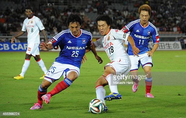 Kensuke Nagai of Nagoya Grampus and Jungo Fujimoto of Yokohama FMarinos compete for the ball during the JLeague match between Yokohama FMarinos and...