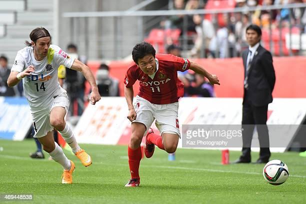 Kensuke Nagai of Nagoya Grampus beats Mikic of Sanfrecce Hiroshima during the JLeague match between Nagoya Grampus anbd Sanfrecce Hiroshima at Toyota...