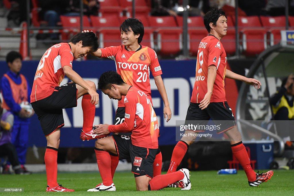 Kensuke Nagai of Nagoya Grampus celebrates his opening goal with teammatesTaishi Taguchi and Asahi Yada of Nagoya Grampus during the JLeague match...