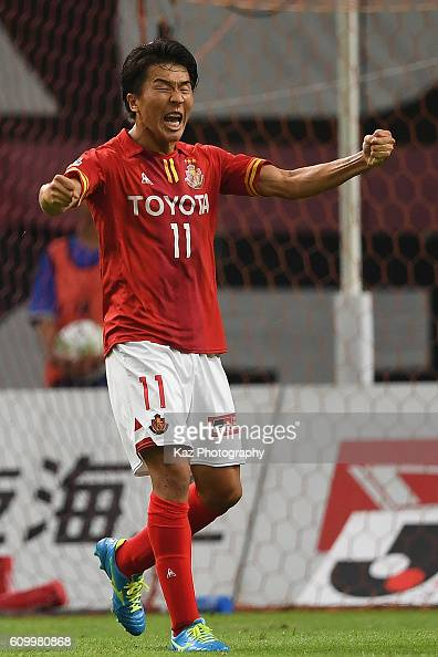Kensuke Nagai of Nagoya Grampus celebrates the equaliser during the J League match between Nagoya Grampus and Gamba Osaka at the Toyota Stadium on...