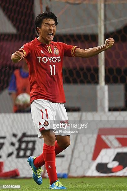 Kensuke Nagai of Nagoya Grampus celebrates the equaliser during the J League match between Nagoya Grampus and Gamba Osaka at the Toyota Stadium on...