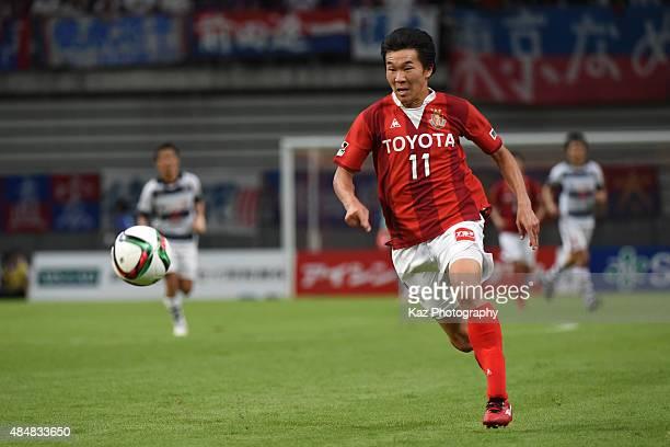 Kensuke Nagai of Nagoya Grampus dribbles the ball during the JLeague match between Nagoya Grampus and FC Tokyo at Toyota Stadium on August 22 2015 in...