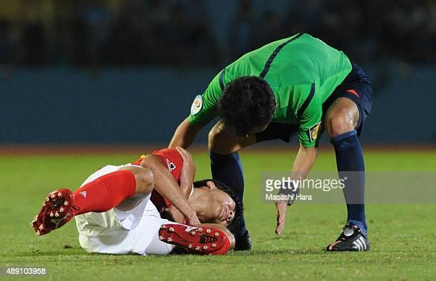 Kensuke Nagai of Nagoya Grampus injured during the JLeague match between Kawasaki Frontale and Nagoya Grampus at Kawasaki Todoroki Stadium on...