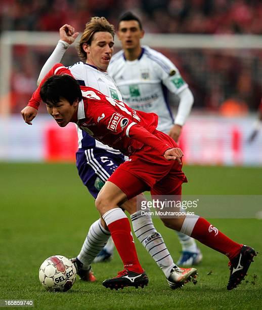 Kensuke Nagai of Standard beats Lucas Biglia of Anderlecht during the Jupiler League match between Royal Standard de Liege and RSC Anderlecht at...