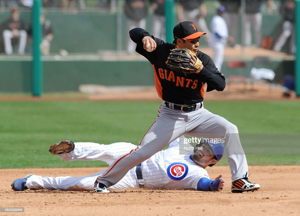Kensuke Tanaka #88 of the San Francisco Giants attempts to turn a double play as <a gi-track='captionPersonalityLinkClicked' href=/galleries/search?phrase=David+DeJesus&family=editorial&specificpeople=206765 ng-click='$event.stopPropagation()'>David DeJesus</a> #9 of the Chicago Cubs slides into second base at HoHoKam Park on February 24, 2013 in Mesa, Arizona.