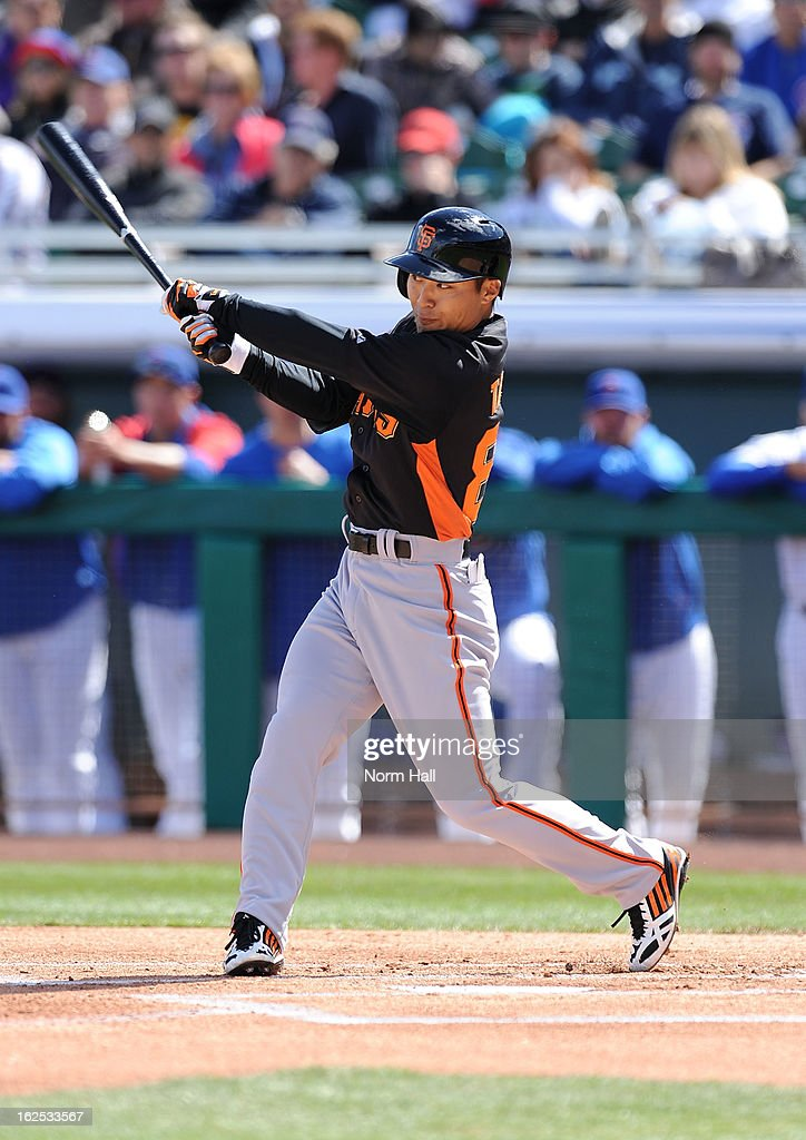 Kensuke Tanaka #88 of the San Francisco Giants follows through on a swing against the Chicago Cubs at HoHoKam Park on February 24, 2013 in Mesa, Arizona.