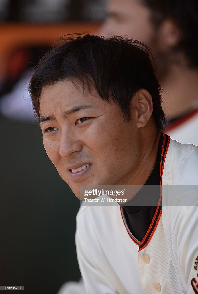 Kensuke Tanaka #37 of the San Francisco Giants looks on from the dugout in the fourth inning against the New York Mets at AT&T Park on July 10, 2013 in San Francisco, California. Tanaka hit a fly ball to left field for an out.