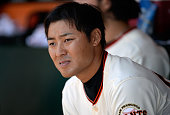 Kensuke Tanaka of the San Francisco Giants looks on from the dugout in the fourth inning against the New York Mets at ATT Park on July 10 2013 in San...