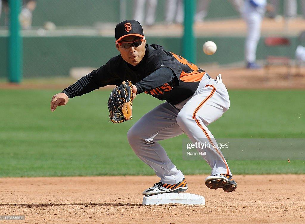 Kensuke Tanaka #88 of the San Francisco Giants makes a play at second base against the Chicago Cubs at HoHoKam Park on February 24, 2013 in Mesa, Arizona.