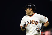 Kensuke Tanaka of the San Francisco Giants runs back to the dugout after grounding out to third base against the Cincinnati Reds at ATT Park on July...