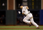 Kensuke Tanaka of the San Francisco Giants runs to second base in the fifth inning of his Major League Baseball debut against the New York Mets at...