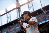 Kensuke Tanaka of the San Francisco Giants waits to bat during his Major League Baseball debut against the New York Mets at ATT Park on July 9 2013...
