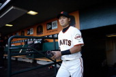 Kensuke Tanaka of the San Francisco Giants walks into the dugout before his Major League Baseball debut game against the New York Mets at ATT Park on...