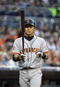 Kensuke Tanaka of the San Francisco Giants warmsup before hitting during the first inning of a baseball game against the San Diego Padres at Petco...