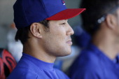 Kensuke Tanaka of the Texas Rangers during a game against the Kansas City Royals at Surprise Stadium on February 27 2014 in Surprise Arizona