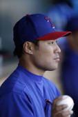 Kensuke Tanaka of the Texas Rangers during a game against the Kansas City Royals at Surprise Stadium on February 27 2014 in Surprise Arizona...