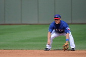 Kensuke Tanaka of the Texas Rangers plays second base in the eighth inning against the Chicago White Sox on March 2 2014 in Surprise Arizona