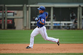 Kensuke Tanaka of the Texas Rangers runs the bases to score in the seventh inning against the Chicago White Sox on March 2 2014 in Surprise Arizona