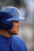 Kensuke Tanaka of the Texas Rangers waits on deck in the seventh inning against the Chicago White Sox on March 2 2014 in Surprise Arizona