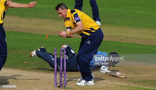 Kent batsman Brendan Nash is ran out by Warwickshire bowler Rikki Clarke during the Royal London OneDay Cup 2014 Semi Final between Warwickshire and...