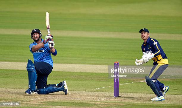 Kent batsman Darren Stevens hits a six watched by Glamorgan wicketkeeper Mark Wallace during the Royal London OneDay Cup match between Glamorgan and...