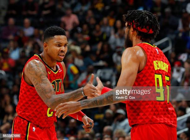 Kent Bazemore and DeAndre' Bembry of the Atlanta Hawks react during the game against the Cleveland Cavaliers at Philips Arena on November 30 2017 in...