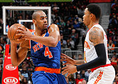Kent Bazemore of the Atlanta Hawks defends against Arron Afflalo of the New York Knicks at Philips Arena on January 5 2016 in Atlanta Georgia NOTE TO...